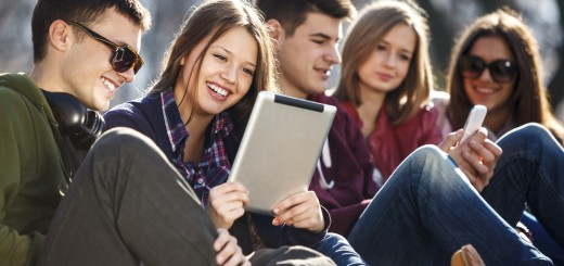 Young and happy urban people having fun with digital tablet